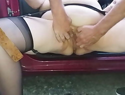 german SSBBW fisting &, squirting at the parking place