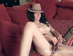 Silki Smith strips naked and sexy on her red bed