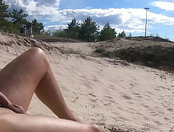 Nudist beach sunbathing, flashing